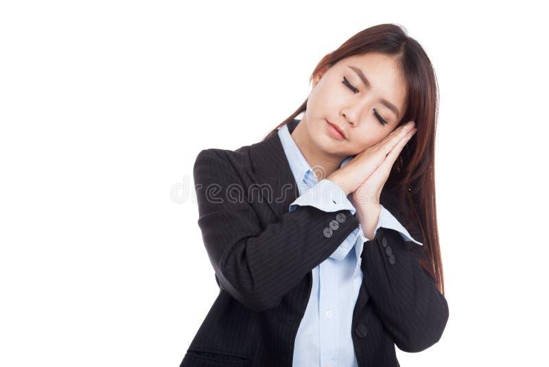 Молодая азиатская коммерсантка представляя показывающ жестами спать стоковые фотографии rf