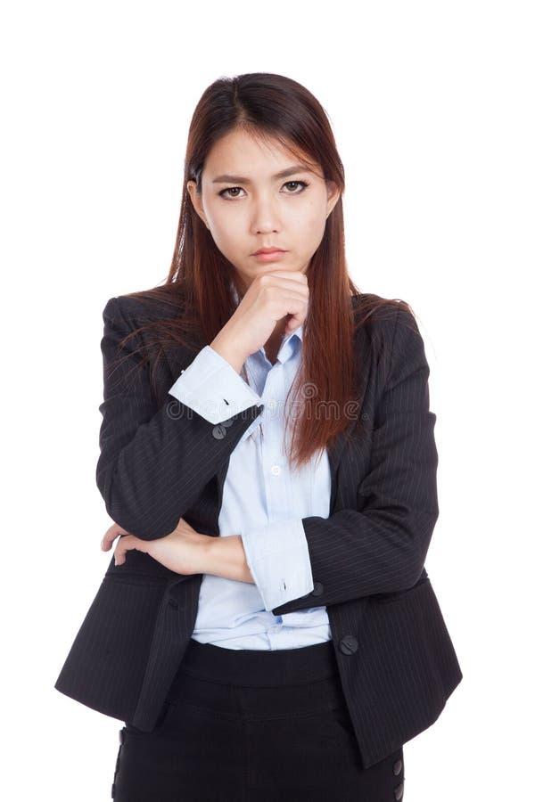 Молодая азиатская коммерсантка думает стоковая фотография rf