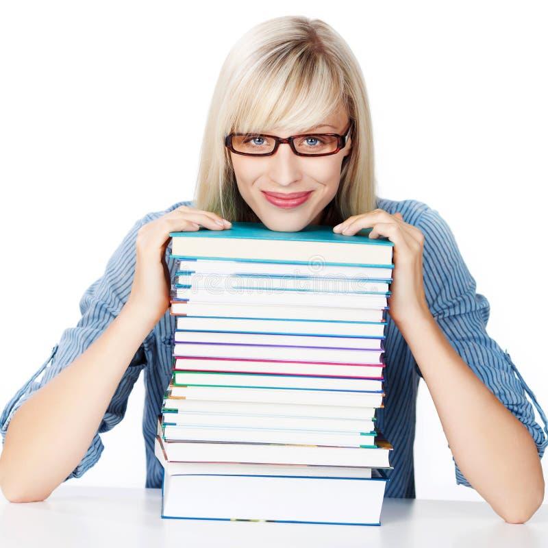 Молодая дама с стогом книг стоковое изображение rf