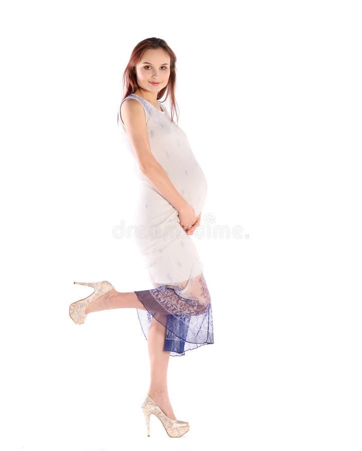 Молодая беременная женщина стоковое фото rf