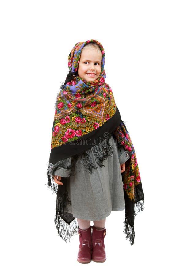 Молодая девушка улыбки носит традиционную русскую бандану стоковое фото rf