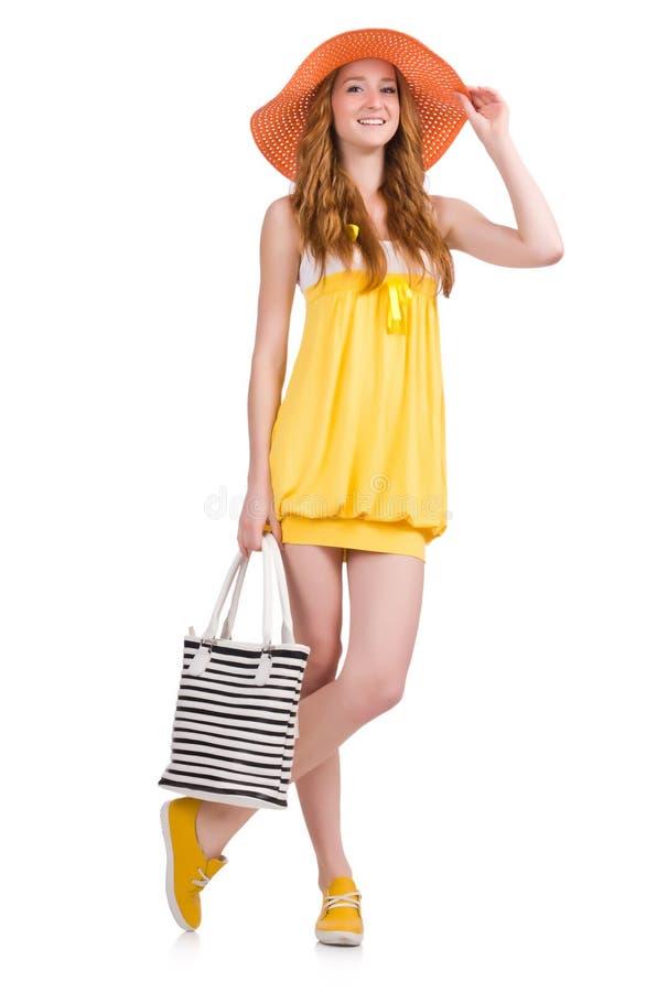 Молодая женщина в желтом платье лета изолированном на стоковое изображение