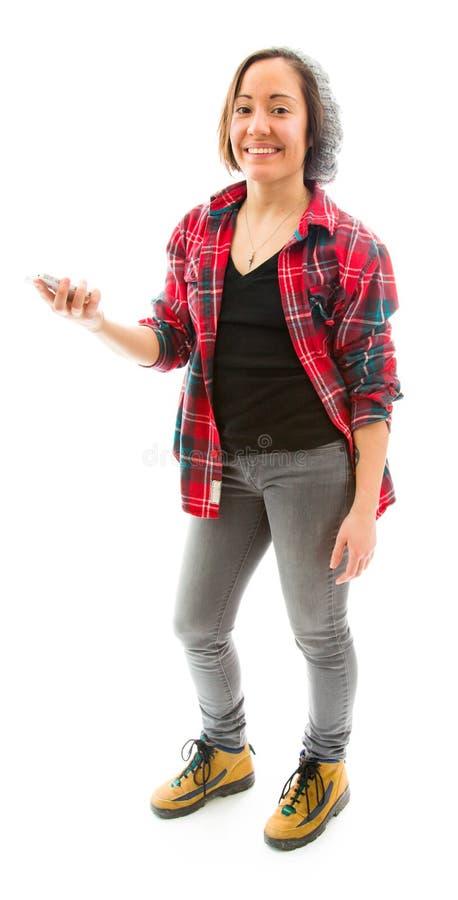 Download Молодая женщина держа дальше мобильный телефон и усмехаться Стоковое Изображение - изображение насчитывающей удерживание, панорамно: 41652077