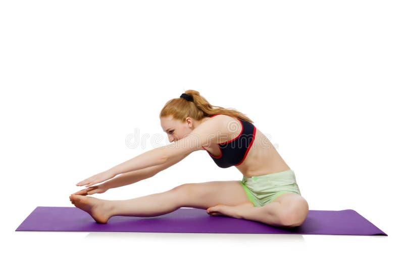 Молодая женщина делая тренировки спорта стоковые изображения rf