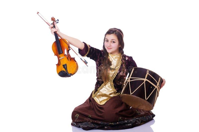 Молодая женщина играя музыкальные инструменты стоковые изображения rf