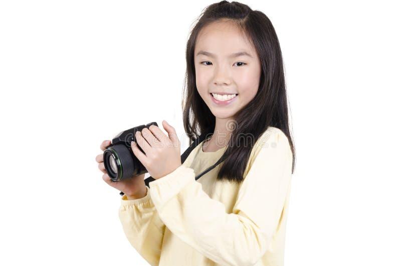 Молодая женщина красоты фотографируя стоковое изображение rf