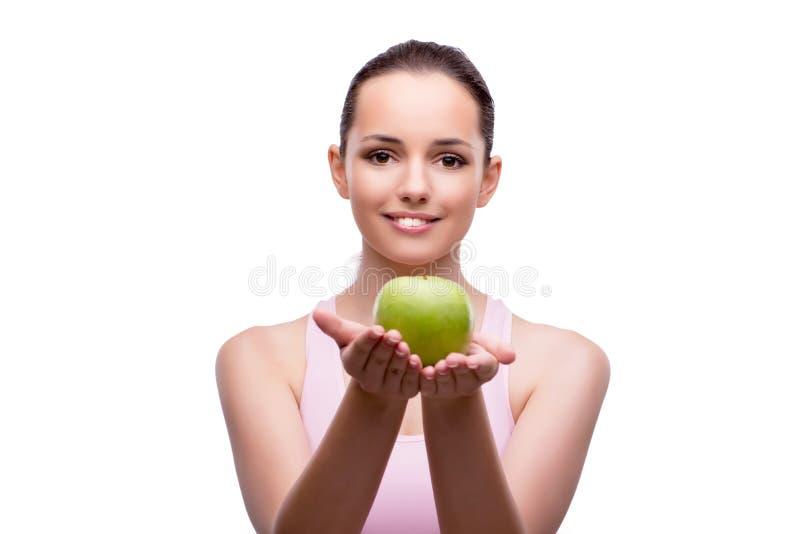 Молодая женщина при зеленое яблоко изолированное на белизне стоковое изображение rf
