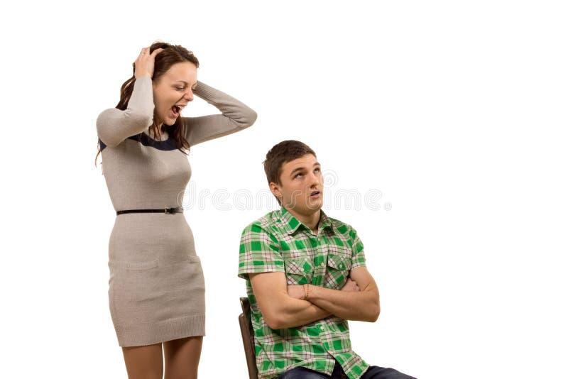 Молодая женщина споря с ее парнем стоковые фотографии rf