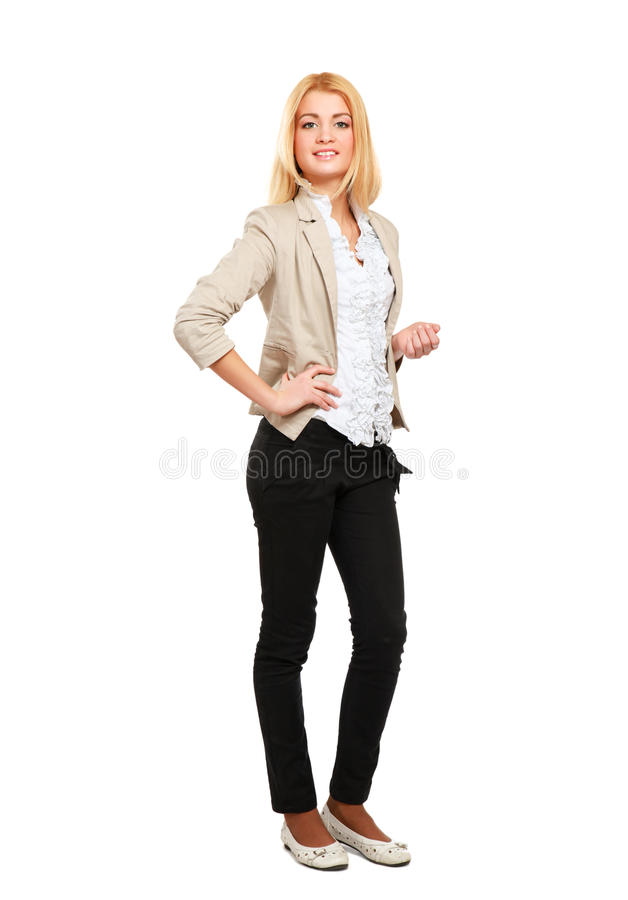 Молодая женщина стоя внутри во всю длину изолированный дальше стоковые изображения