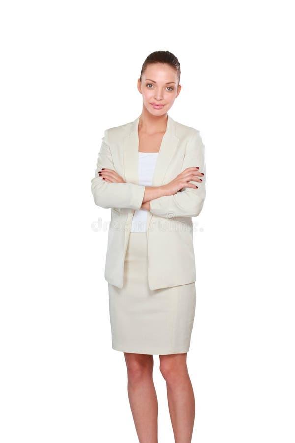 Молодая женщина стоя на белой предпосылке стоковая фотография