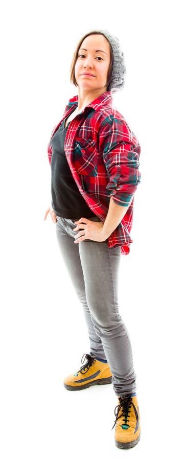 Download Молодая женщина стоя с ее оружиями подбоченясь Стоковое Изображение - изображение насчитывающей доверие, ботинок: 41650927