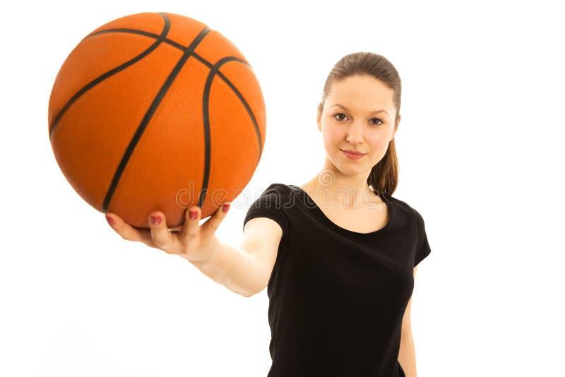 Молодая женщина с баскетболом стоковое фото rf