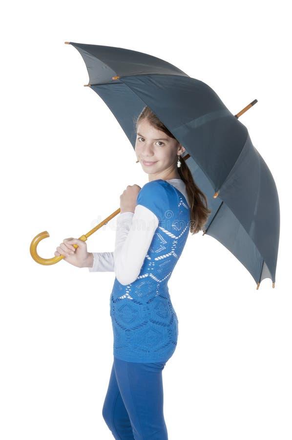 Молодая женщина с зонтиком стоковые изображения