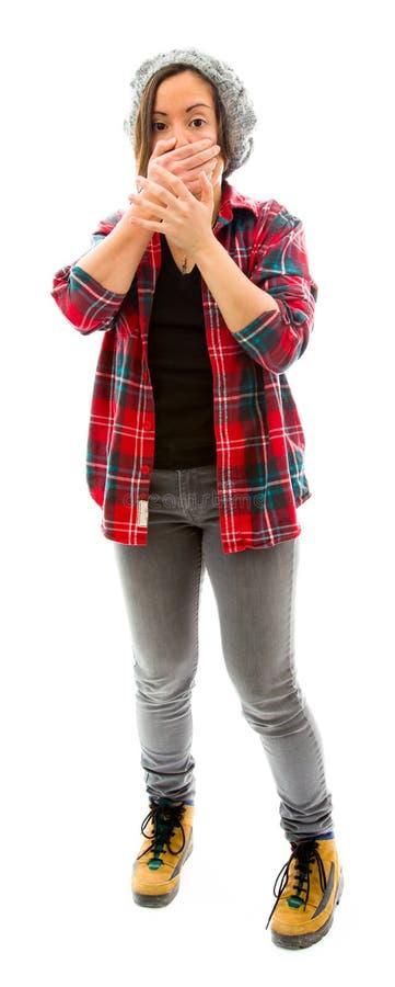 Download Молодая женщина с рукой над ее ртом и ударом Стоковое Фото - изображение насчитывающей заволакивание, портрет: 41651536