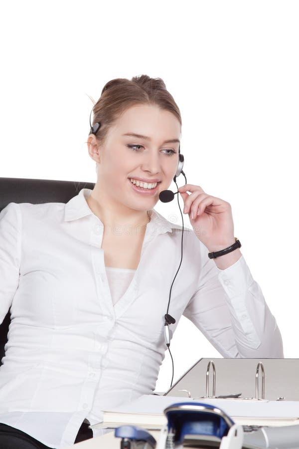 Download Молодая женщина с шлемофоном сидит на столе Стоковое Фото - изображение насчитывающей персона, счастливо: 40580672