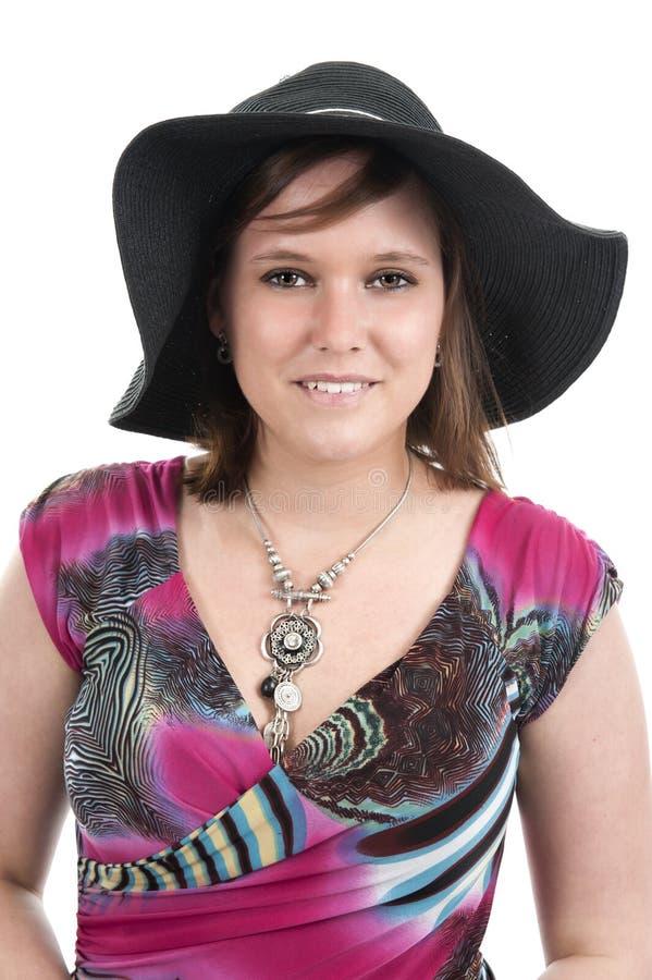 Молодая женщина с шляпой стоковое изображение rf