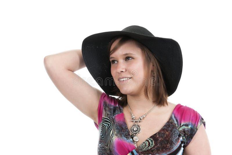 Молодая женщина с шляпой стоковые фотографии rf