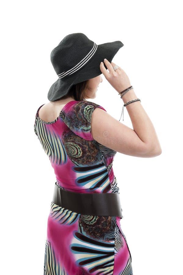 Молодая женщина с шляпой стоковые изображения rf