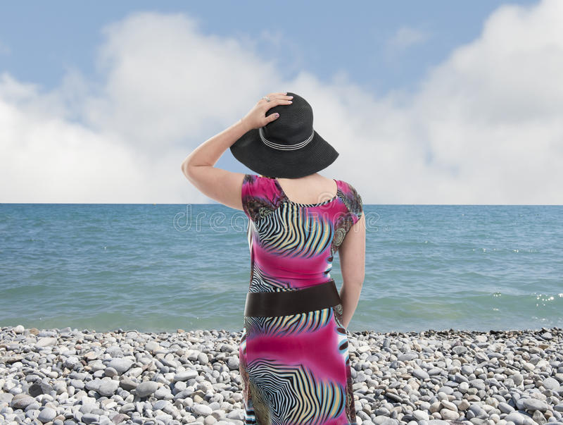 Молодая женщина с шляпой стоковое фото rf