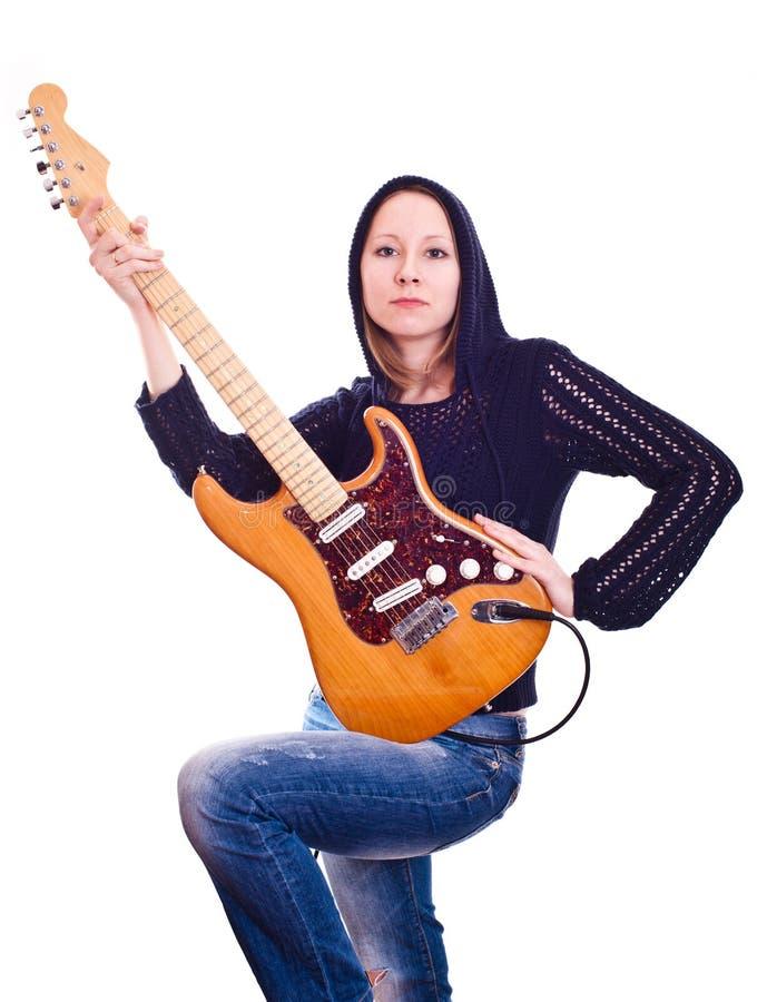 Женщина с электрической гитарой стоковая фотография rf