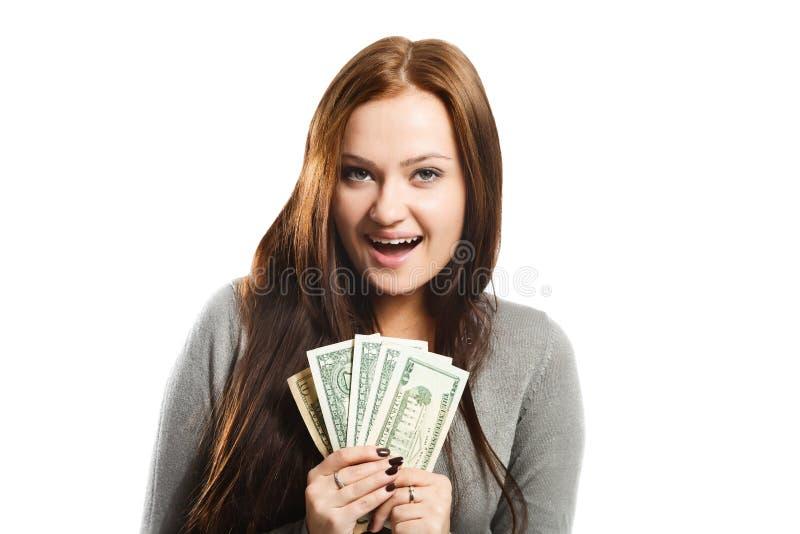 Молодая жизнерадостная женщина с долларами в ее руках, изолированных на wh стоковые фотографии rf