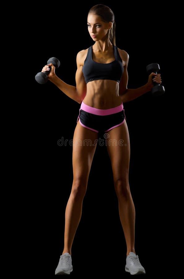 Молодая изолированная девушка фитнеса стоковое фото