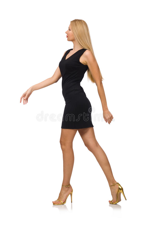 Молодая милая женщина в мини черном платье изолированном дальше стоковая фотография