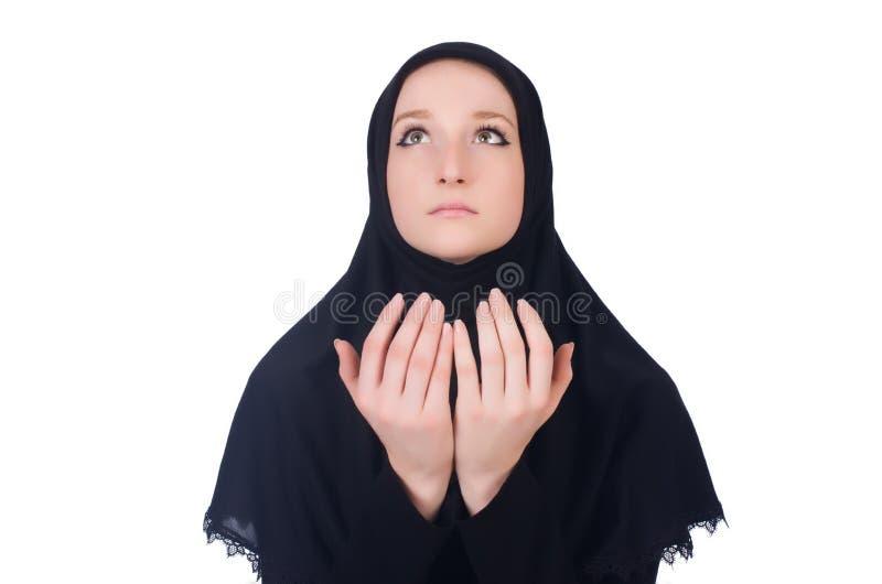 Молодая мусульманская женщина моля стоковые фотографии rf