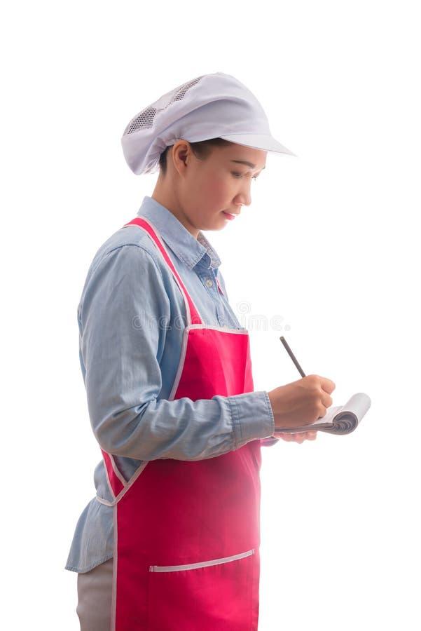 Молодая официантка принимая заказ, изолированный на белой предпосылке стоковое изображение rf