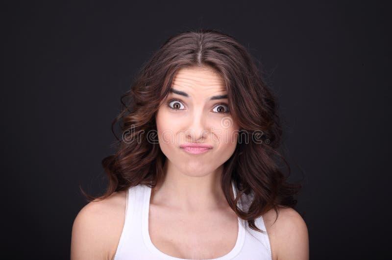 Молодая сердитая девушка. стоковые фото