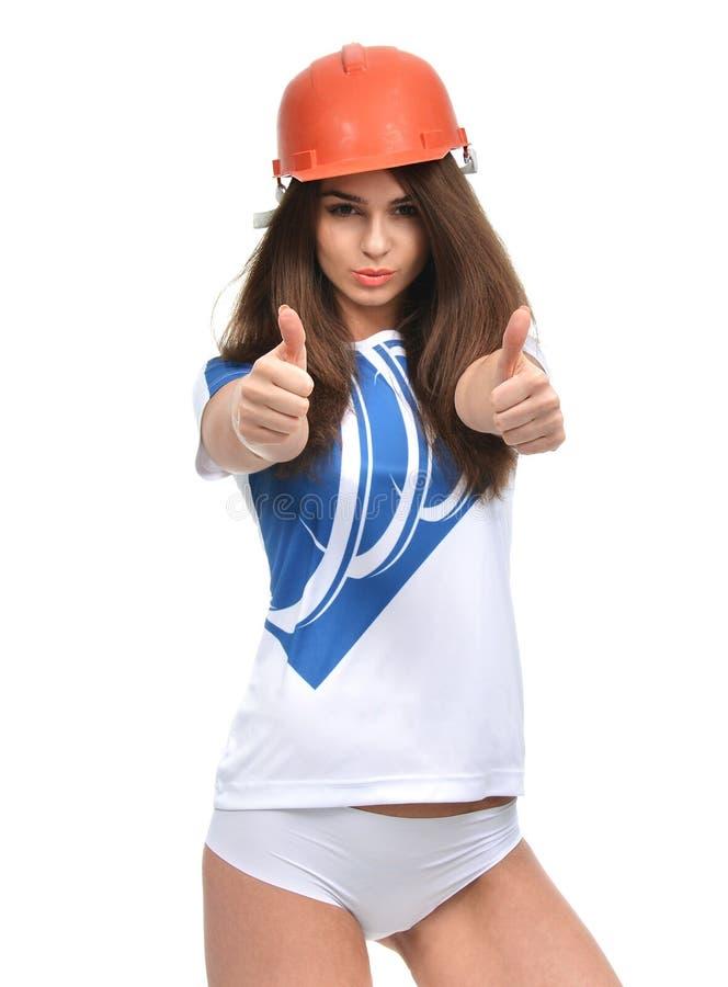 Молодая сильная красивая женщина показывая смеяться над больших пальцев руки вверх усмехаясь стоковое фото rf