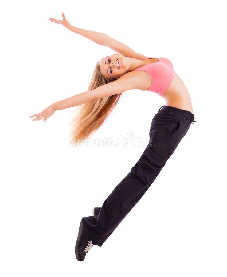 Молодая счастливая женщина скача высоко стоковое изображение