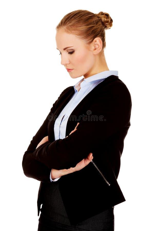 Молодая унылая и обиденная бизнес-леди стоковые фотографии rf