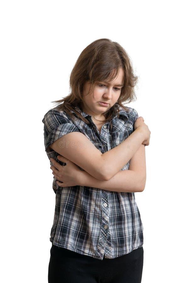 Молодая унылая подавленная женщина изолированная на белой предпосылке стоковое изображение rf