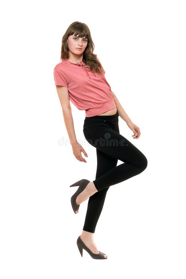 Молодая шаловливая женщина в черные гетры. Изолированный стоковая фотография rf