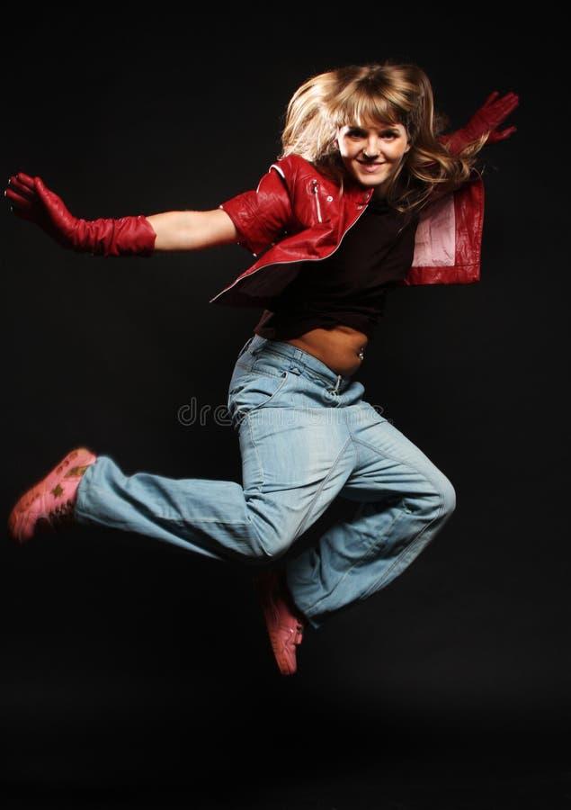 Молодое женское танцы стоковое фото