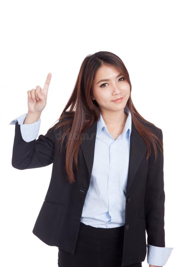 Молодой азиатский пункт коммерсантки поднимающий вверх и улыбка стоковое изображение