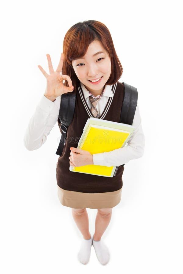 Молодой азиатский студент изолированный на белой предпосылке. стоковое изображение rf