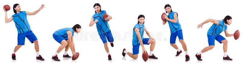 Молодой американский футболист на белизне стоковое фото rf