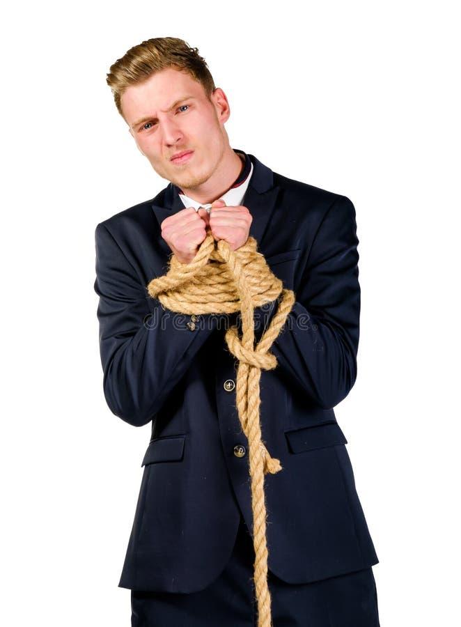 Молодой бизнесмен в костюме связанном вверх стоковое фото rf