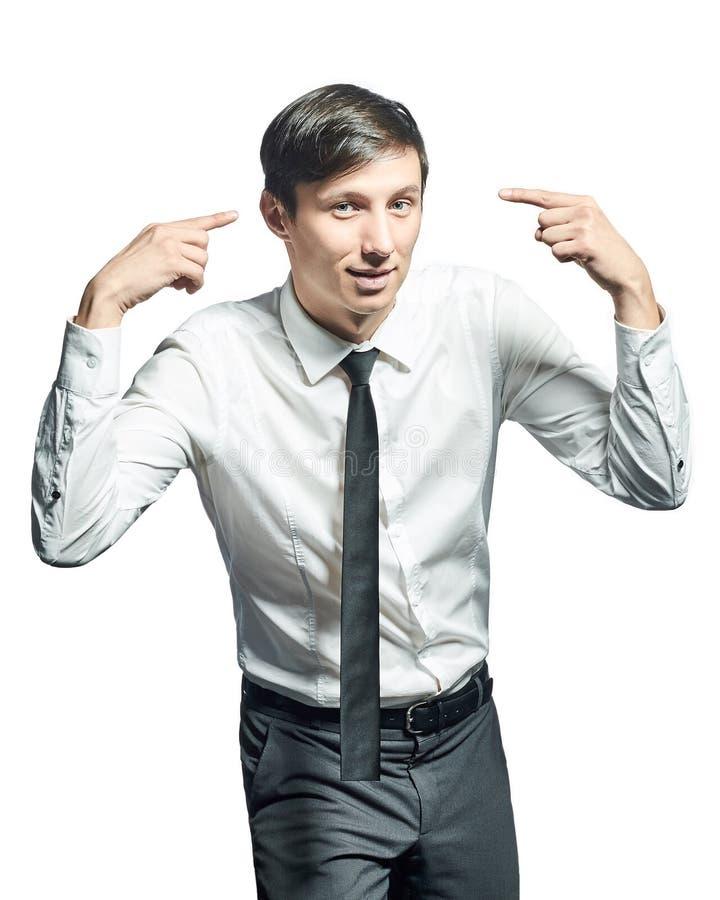 Молодой бизнесмен держа его пальцы на его висках стоковые фотографии rf