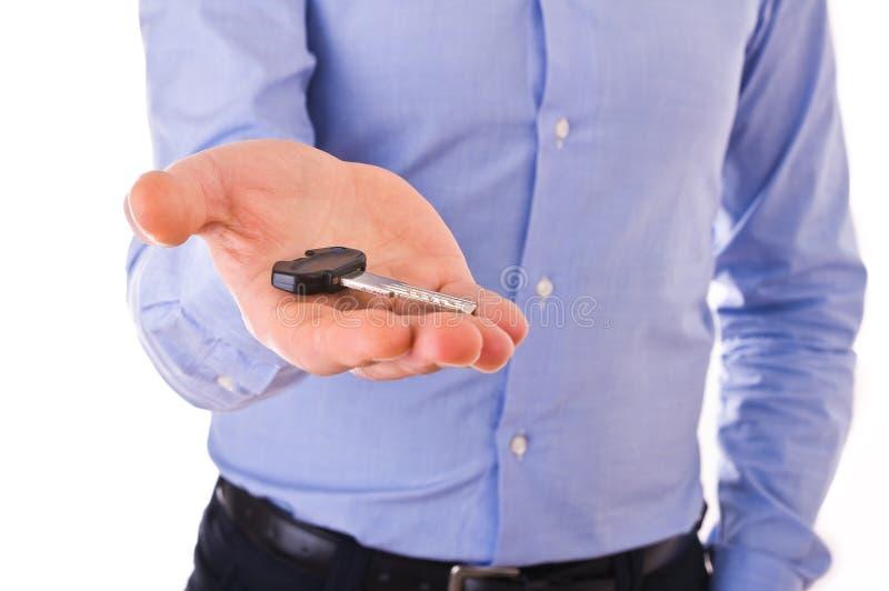Бизнесмен держа ключ. стоковые изображения rf