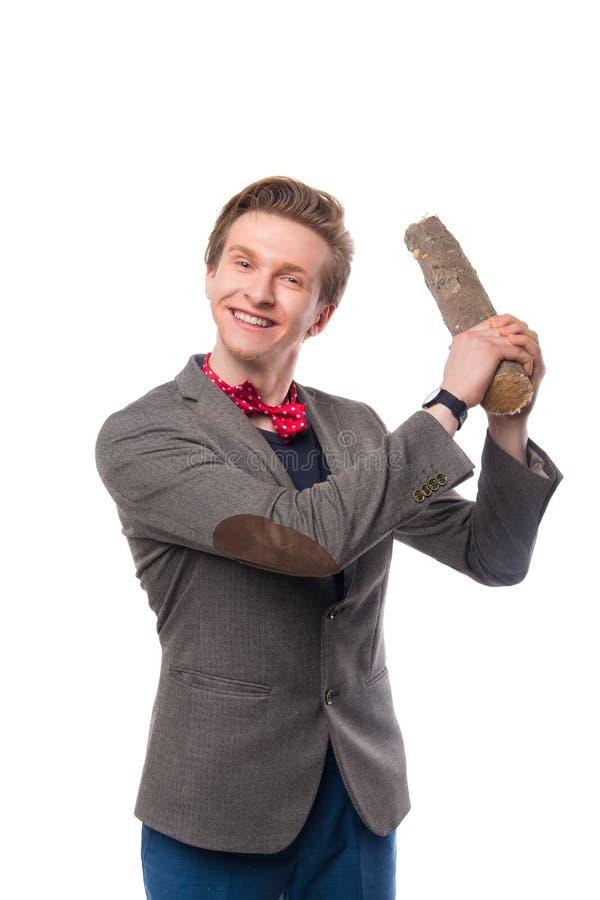 Молодой бизнесмен при бейсбольная бита изолированная на белизне стоковые фото