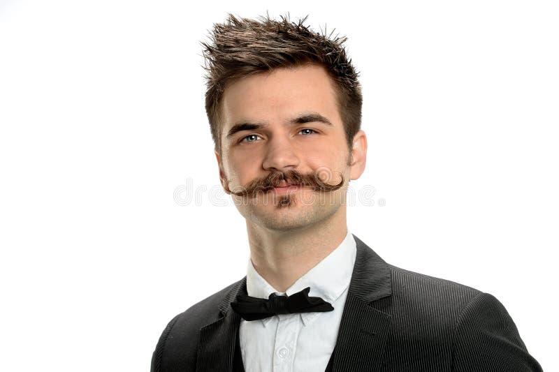Молодой бизнесмен с причудливым усиком стоковое фото rf