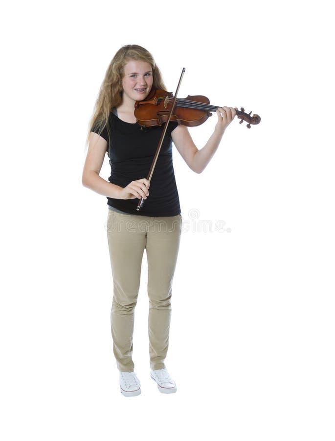 Молодой девочка-подросток играя скрипку стоковое изображение rf