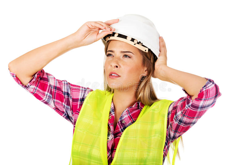 Молодой женский построитель смотря вверх стоковое фото rf
