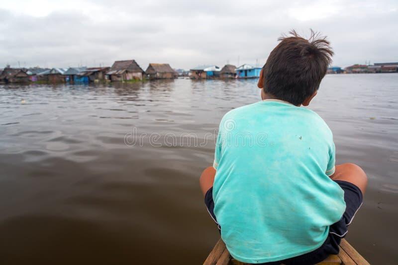 Молодой мальчик на каное стоковая фотография rf