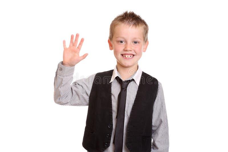 Молодой мальчик развевая на камере стоковое изображение rf