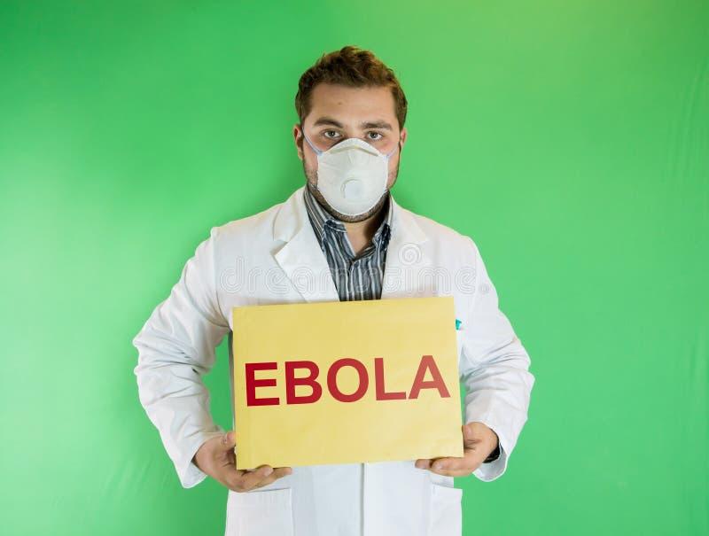 Молодой доктор с знаком Ebola стоковое изображение