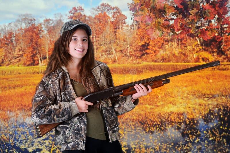 Молодой охотник осенью стоковое фото